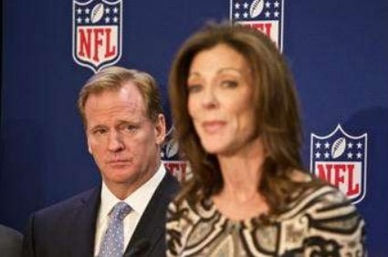 NFL commissioner Roger Goodell (l.) looks on as Dallas Cowboys Executive Vice President Charlotte Jones Anderson speaks at a press conference