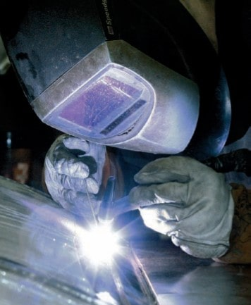 article-christian-science-monitor-school-is-a-factory-A-worker-welds-a-stainless-steel-tank