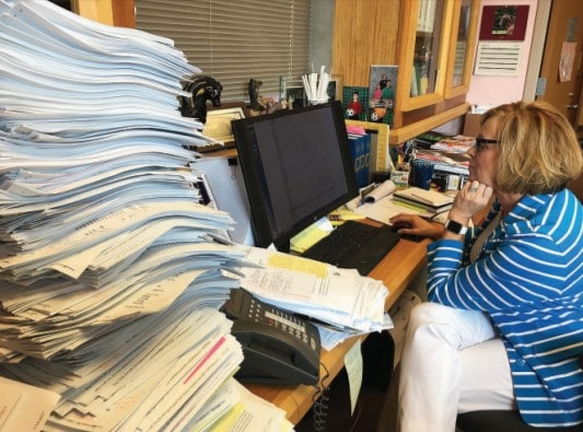 article-cq-researcher-photo-foster-care-woman-working-with-papers