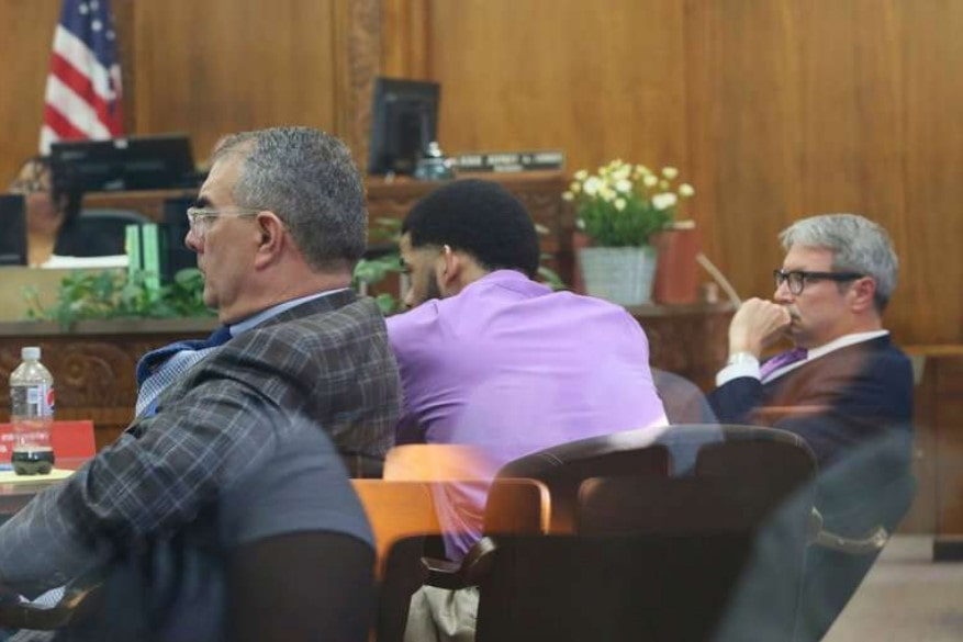 Dominique Heaggan-Brown, center, with his lawyers at the opening of his trial in Milwaukee on Tuesday in the killing of Sylville K. Smith. If convicted of first-degree reckless homicide, Mr. Heaggan-Brown, a former police officer, could face up to 60 years in prison