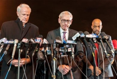 From left, Mayor Tom Barrett of Milwaukee, Gov. Tony Evers of Wisconsin and Lt. Gov. Mandela Barnes during a moment of silence before a news conference.