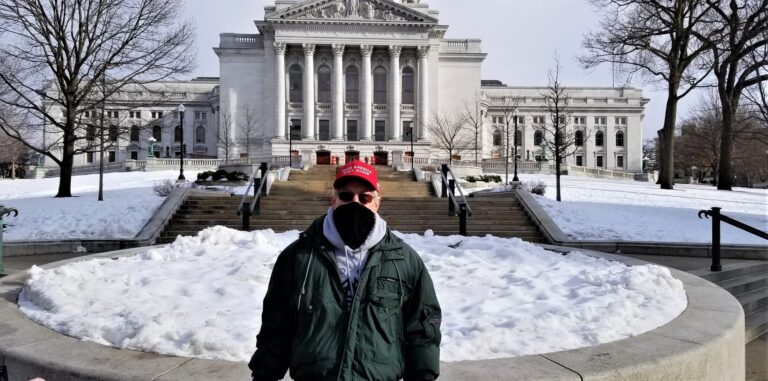 Ronald Faust, a supporter of President Trump, standing by the Capitol building in Madison, Wisconsin. Kay Nolan for Insider